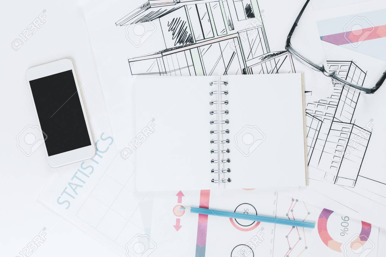 hight resolution of stock photo top view of white office table with blank notepad smartphone and other objects mock up