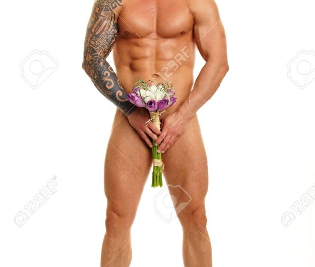 Handsome Naked Muscular Man Poses With Bouguet Of Tulips Stock Photo