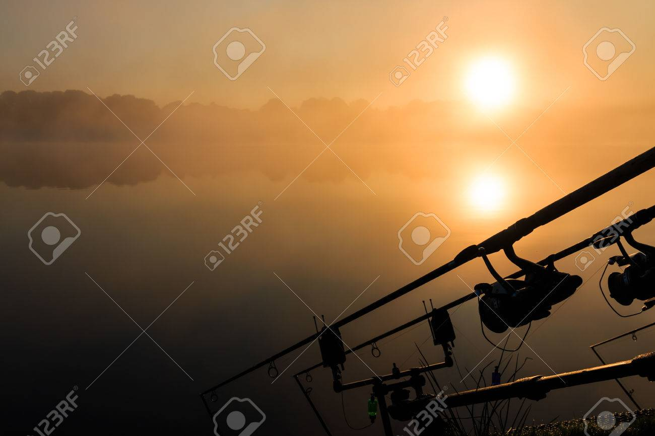 Carp Fishing On A Misty Lake At Sunrise In The Center Of France