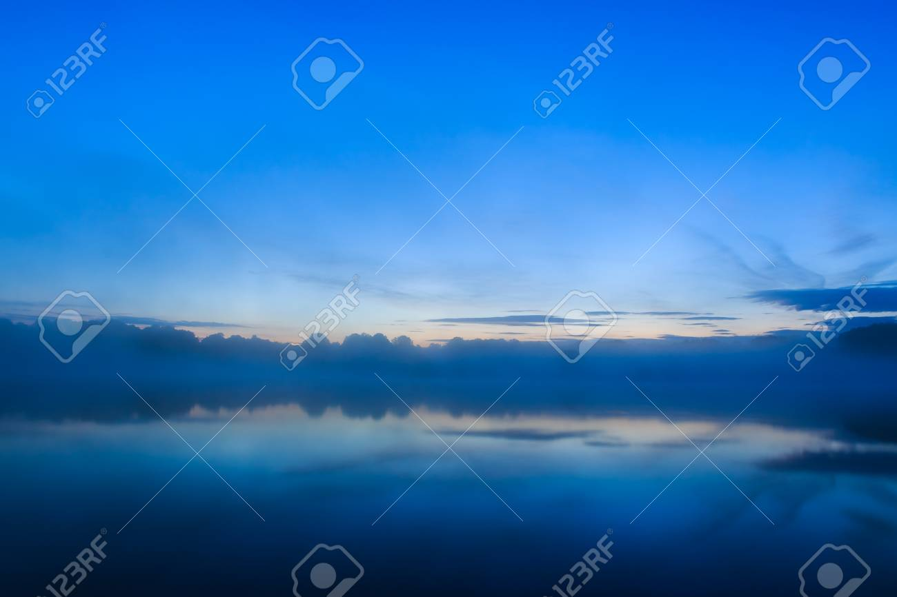 Misty Sunrise Over A Beautiful Lake In The Center Of France