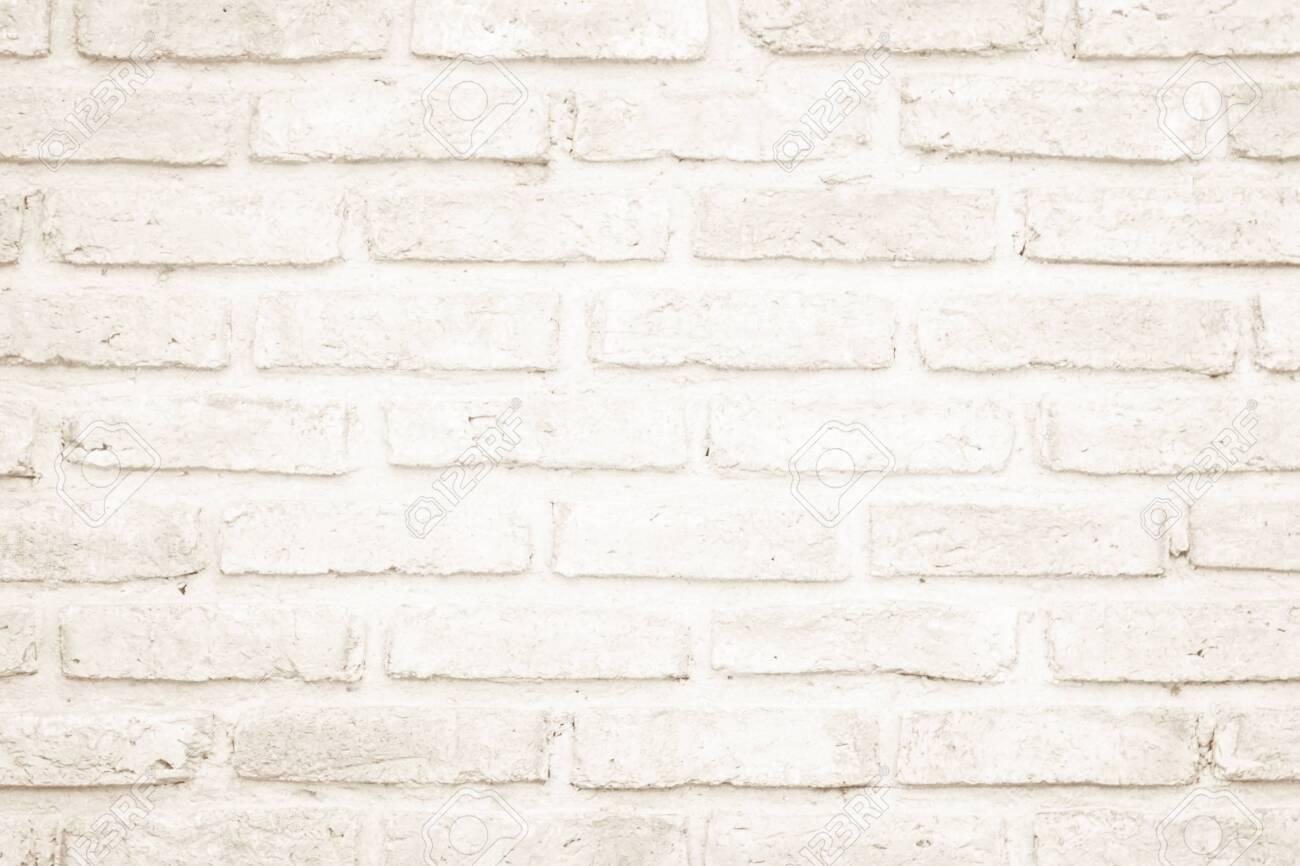 wall cream brick wall texture background in room at subway brickwork