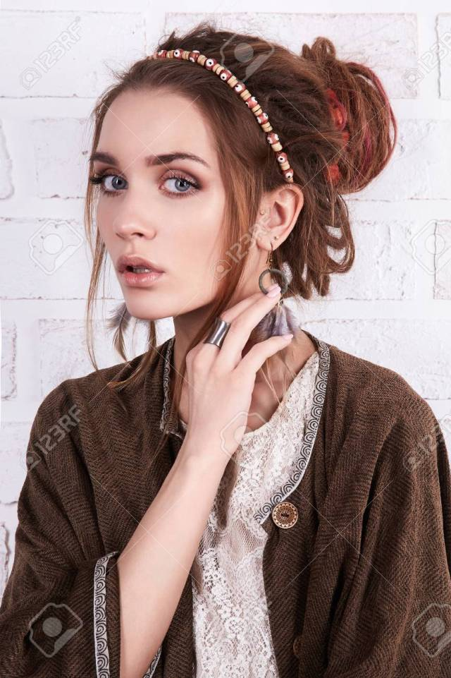 stylish hipster girl with hairstyle and accessories.fashion beautiful..