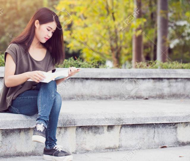 Asian Teen Women Reading Book Happiness And Smile Enjoy Education In University Stock Photo