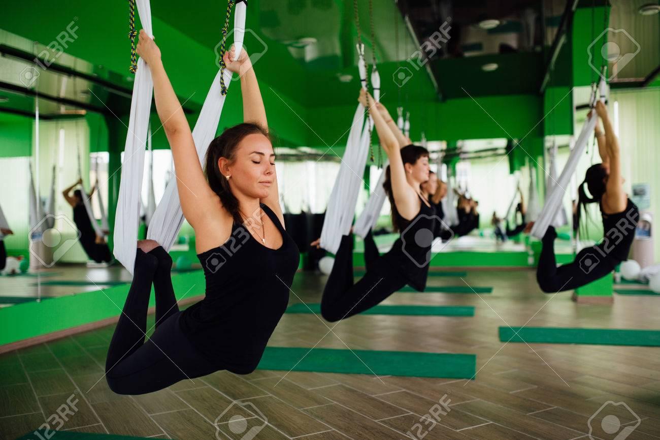 Young Women Making Antigravity Yoga Exercises With A Group Of Stock Photo Picture And Royalty Free Image Image 70638058