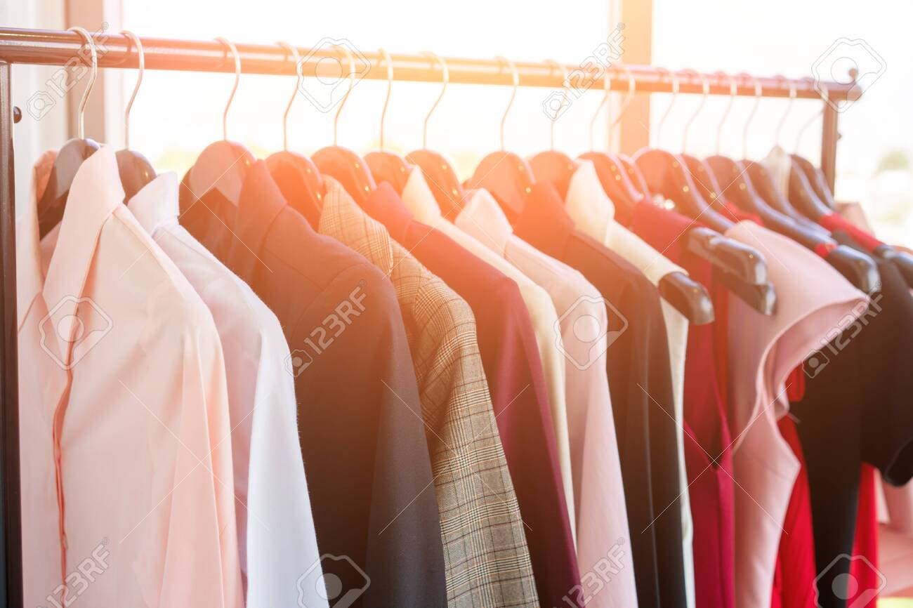 clothes hang on a shelf in a designer clothes store clothes stock photo picture and royalty free image image 145073556