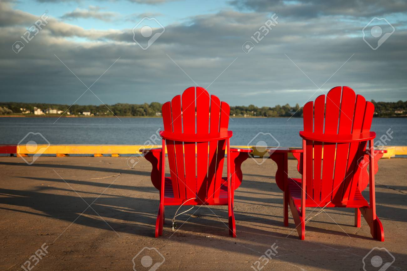 Red Adirondack Chairs 2 Red Adirondack Chairs In Front Of The Ocean In Prince Edward