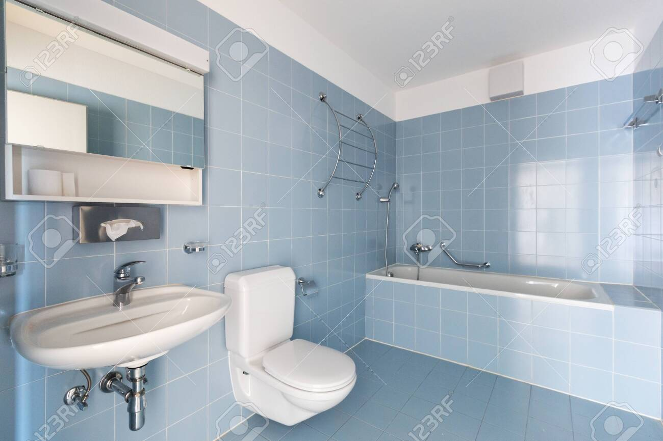 bathroom with vintage blue tiles sink and toilet nobody inside stock photo picture and royalty free image image 132019447