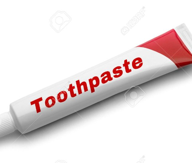 Red Tube Of Toothpaste Isolated On White Background Stock Photo