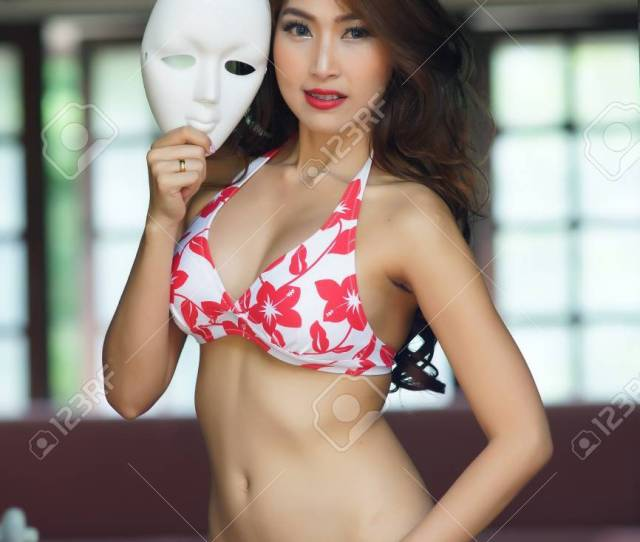 Stock Photo Young Beautiful Asian Woman In Red Bikini With Short Pants Jean Voluptuous Posing Outdoors