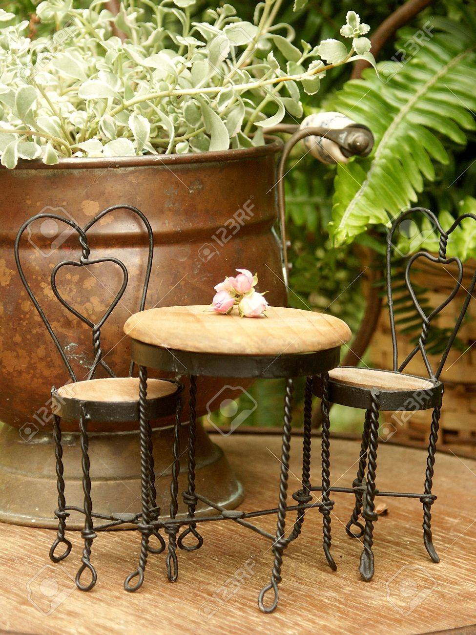 ice cream table and chairs dark wood folding miniature with fern copper pot stock photo 1228871