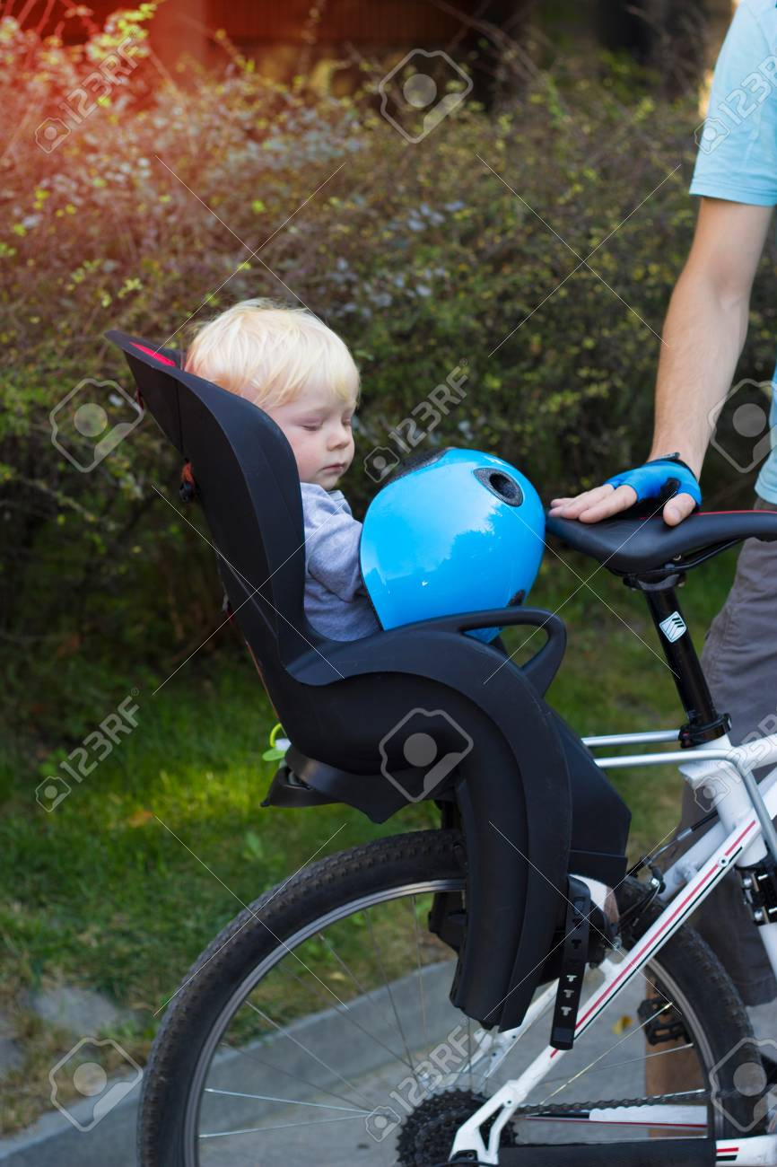 the bike chair michael guineys covers father and son traveling on bicycle child is sitting in a with helmet