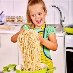 Kitchen Kid Appliences Children Eating Spaghetti At Cooking Stock Photo 38905800