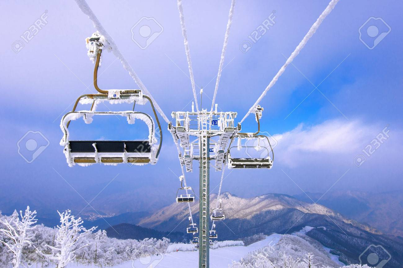 ski chair lift power wheelchair is covered by snow in winter korea stock photo 50551654