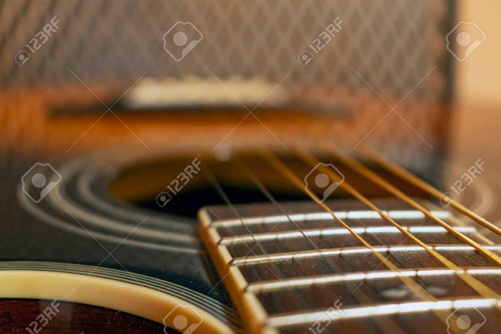 medium resolution of classic vintage acoustic guitar with visible frats and wires close up view stock photo