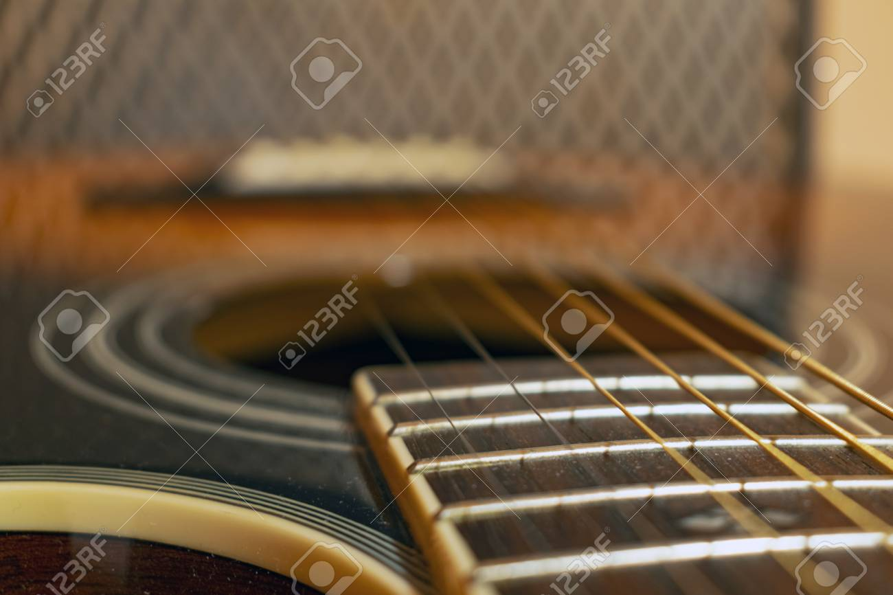 hight resolution of classic vintage acoustic guitar with visible frats and wires close up view stock photo