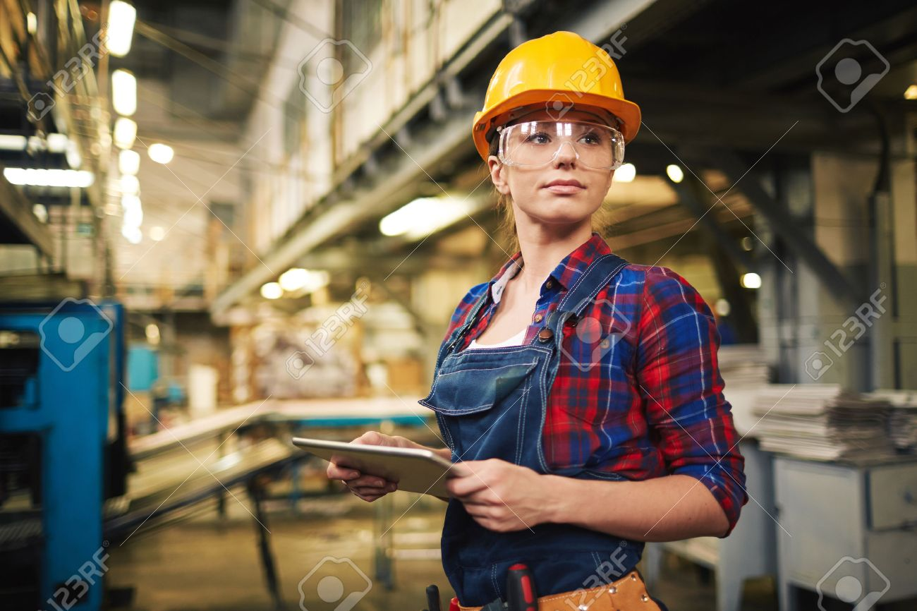 young factory worker controlling