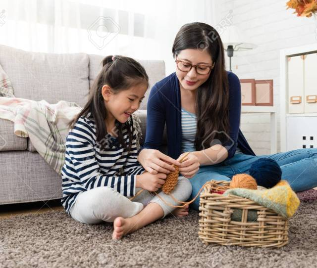 Beautiful Asian Mom Teaches Her Daughter How To Knitting For The Autumn Sweater For Cold Season