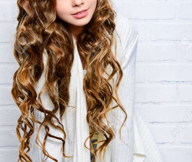 Lovely Teenager Girl With Beautiful Long Curly Hair Wears White Knitted Jersey Beauty Fashion