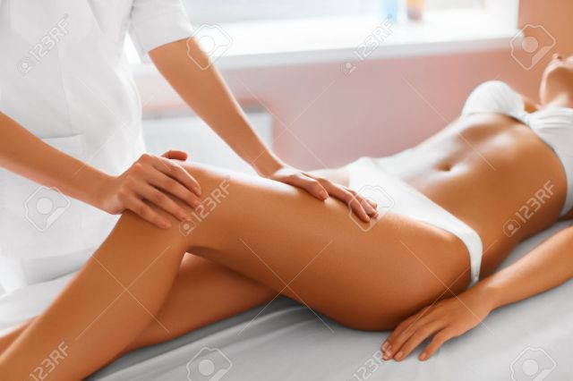 Close Up Of Sexy Woman Getting Spa Treatment Leg Massage Therapy