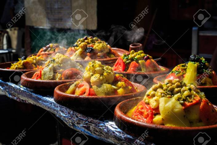 A lot of warm tajnes with delicious vegetables