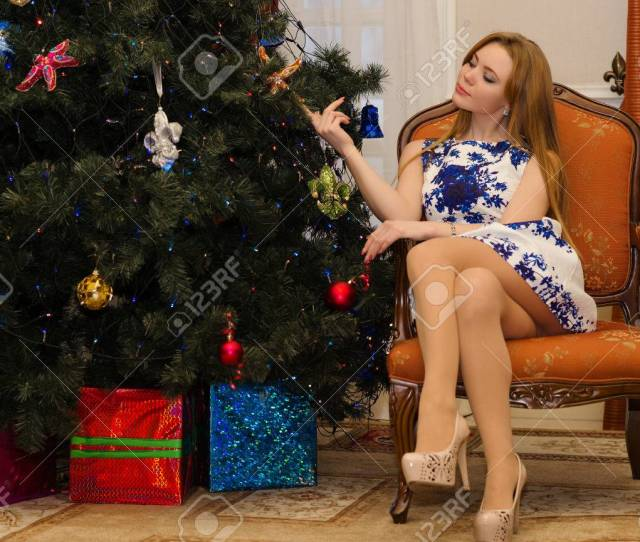 Sexy Woman Sitting On Chair With Legs Crossed Stock Photo 70214019