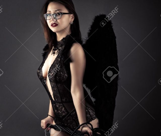 Sexy Korean Girl With Whip In Hands With Black Wings Stock Photo