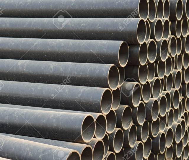 High Density Polyethylene Hdpe Pipe Tube Stack In Nature Evening Sun Light Stock
