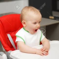 High Chairs For Small Babies Cheap Outdoor Chaise Lounge A Child Eats Jam And Cereal Sits On Highchair Stock Photo 77825772