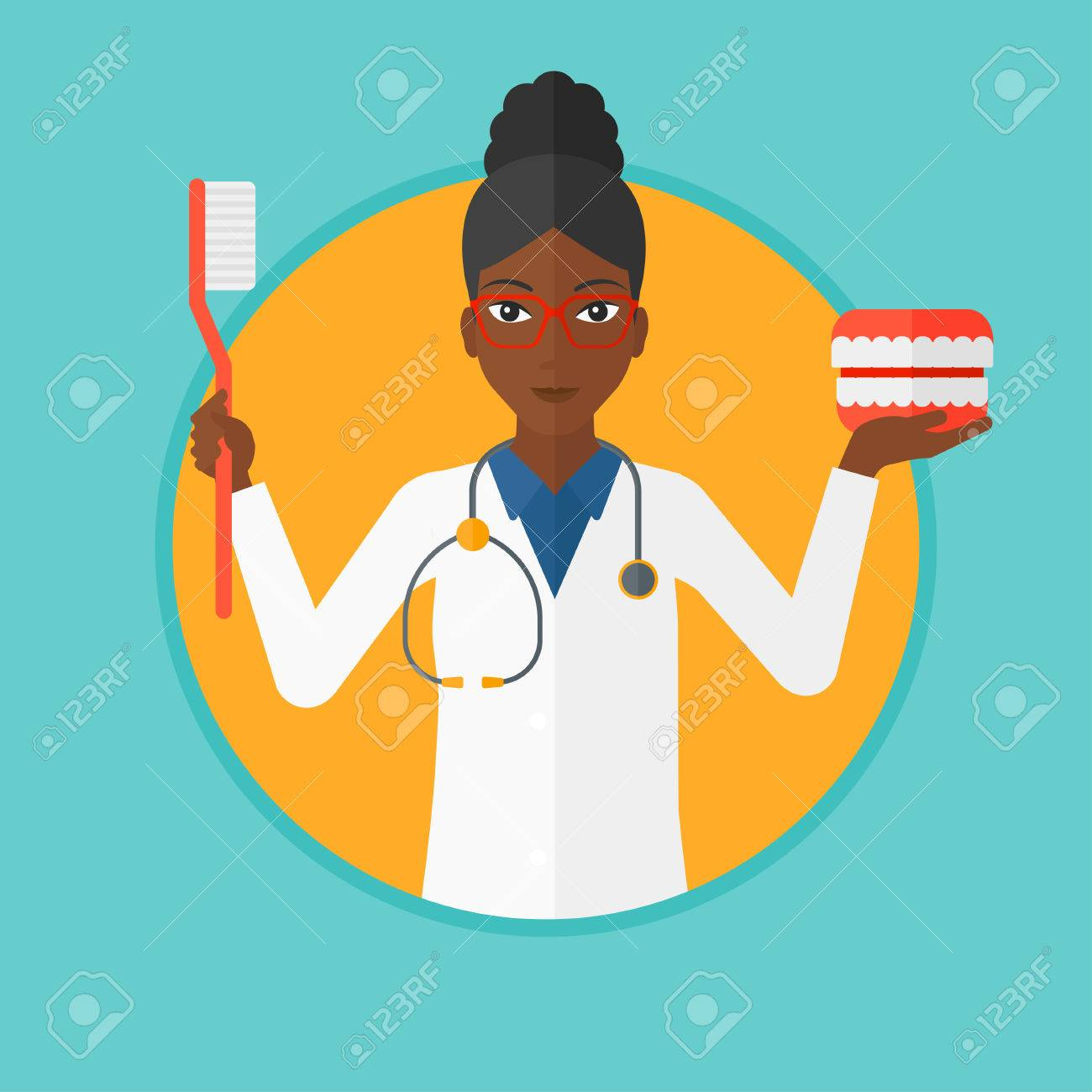 hight resolution of an african american dentist holding dental jaw model and a toothbrush female dentist showing