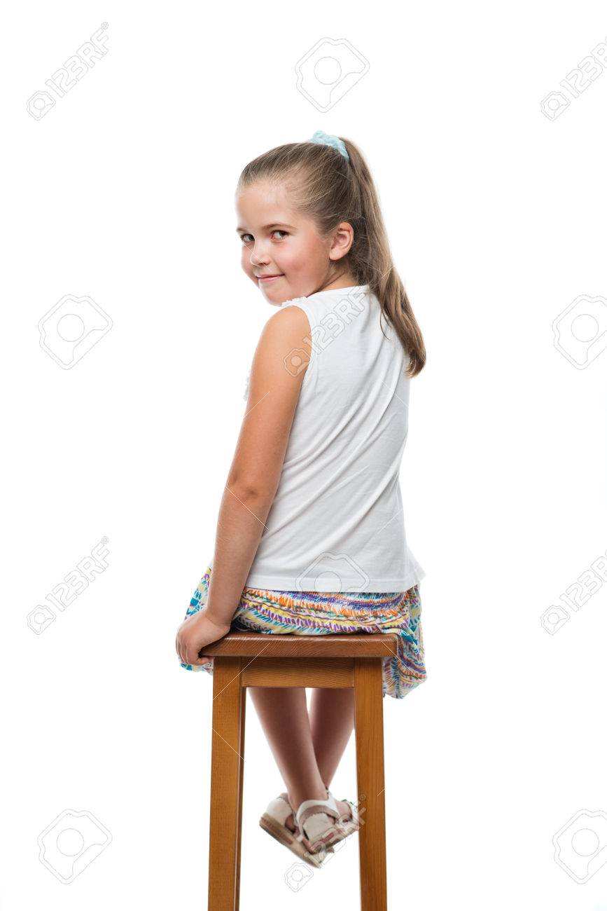 little girl chairs adirondack wine barrel back view of sitting on chair looking to the camera stock photo