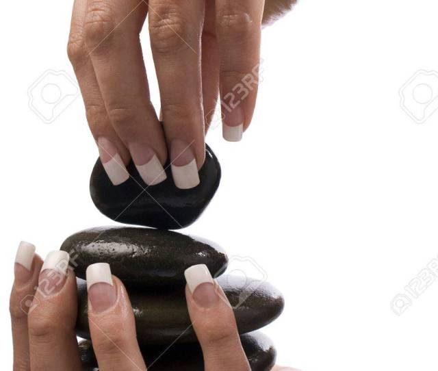Beautiful Hand With French Nails Holding Oiled Massage Stones Stock Photo