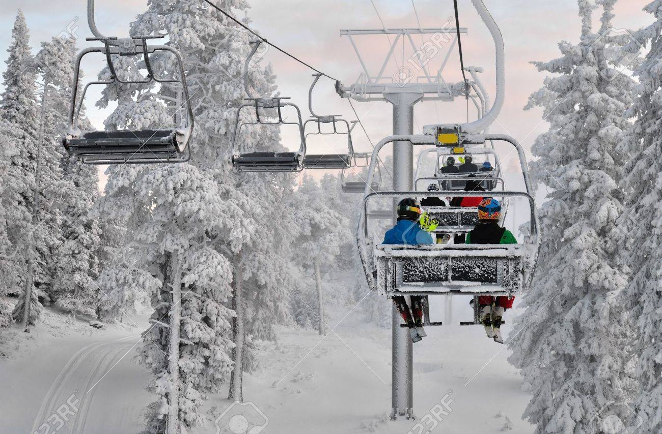 ski chair lift mid back office with skiers resort in ruka finland stock photo 12439429