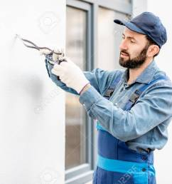 builder mounting electric wiring on the building facade for outdoor lighting stock photo 112134069 [ 1300 x 867 Pixel ]