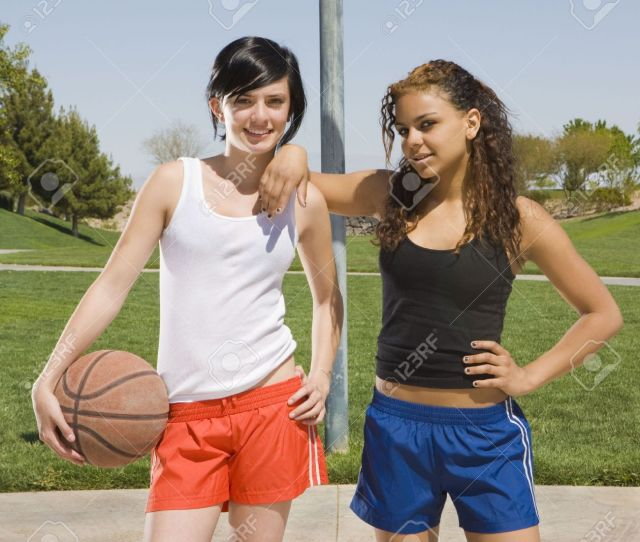 Stock Photo Two Teen Girls Hang Out At A Basketball Court