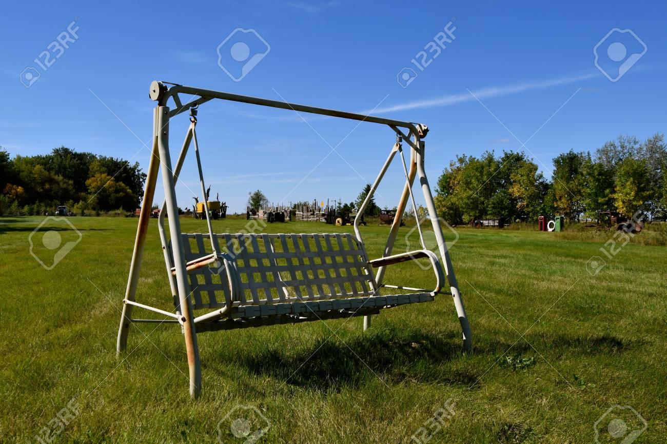 Swinging Chair Comfortable Outdoor Swinging Chair For Two In A Pasture With