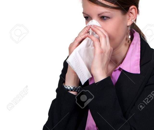 A Beautiful Woman With A Cold Hay Fever Or Allergies Blowing Her Nose Stock Photo