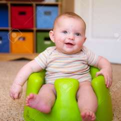 Baby Chairs To Help Sit Up Swivel Chair Downton Abbey Boy Using Training Bumbo Seat Stock Photo Picture 27689265