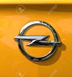 stock photo turin italy june 9 2016 yellow opel logo on a orange body car [ 1300 x 866 Pixel ]
