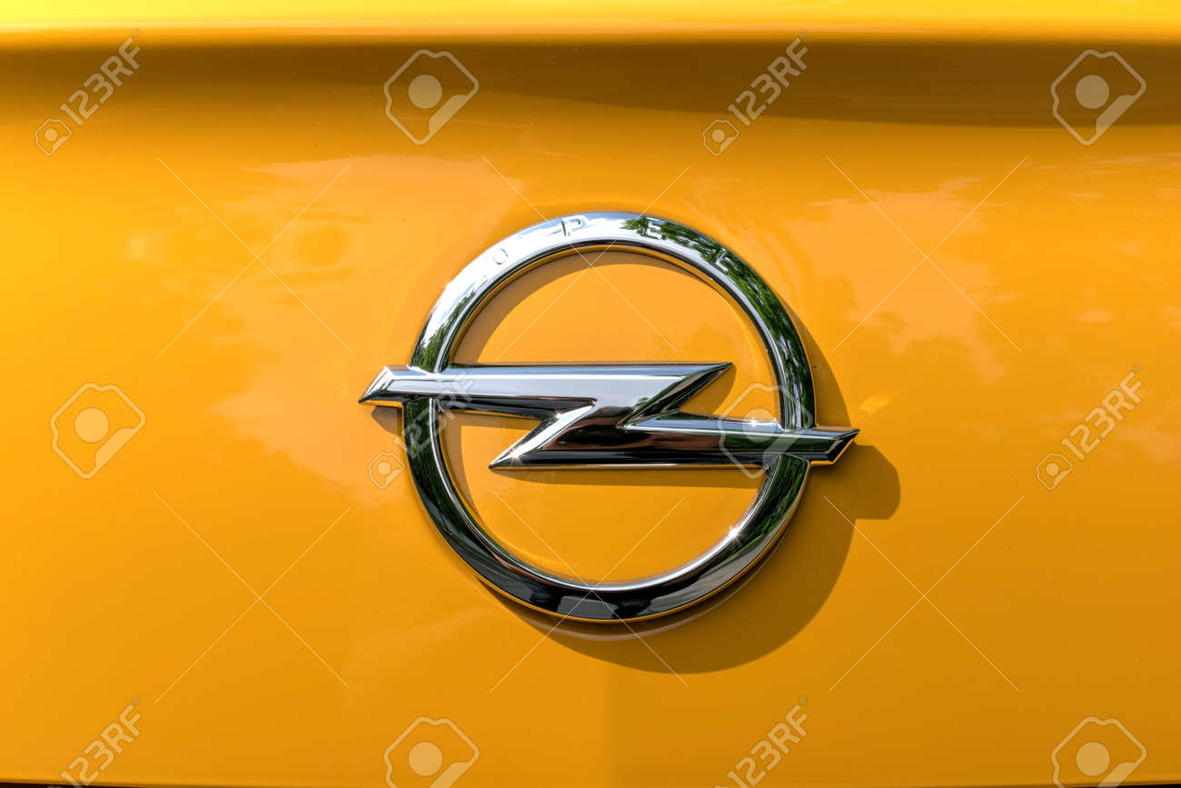 hight resolution of stock photo turin italy june 9 2016 yellow opel logo on a orange body car