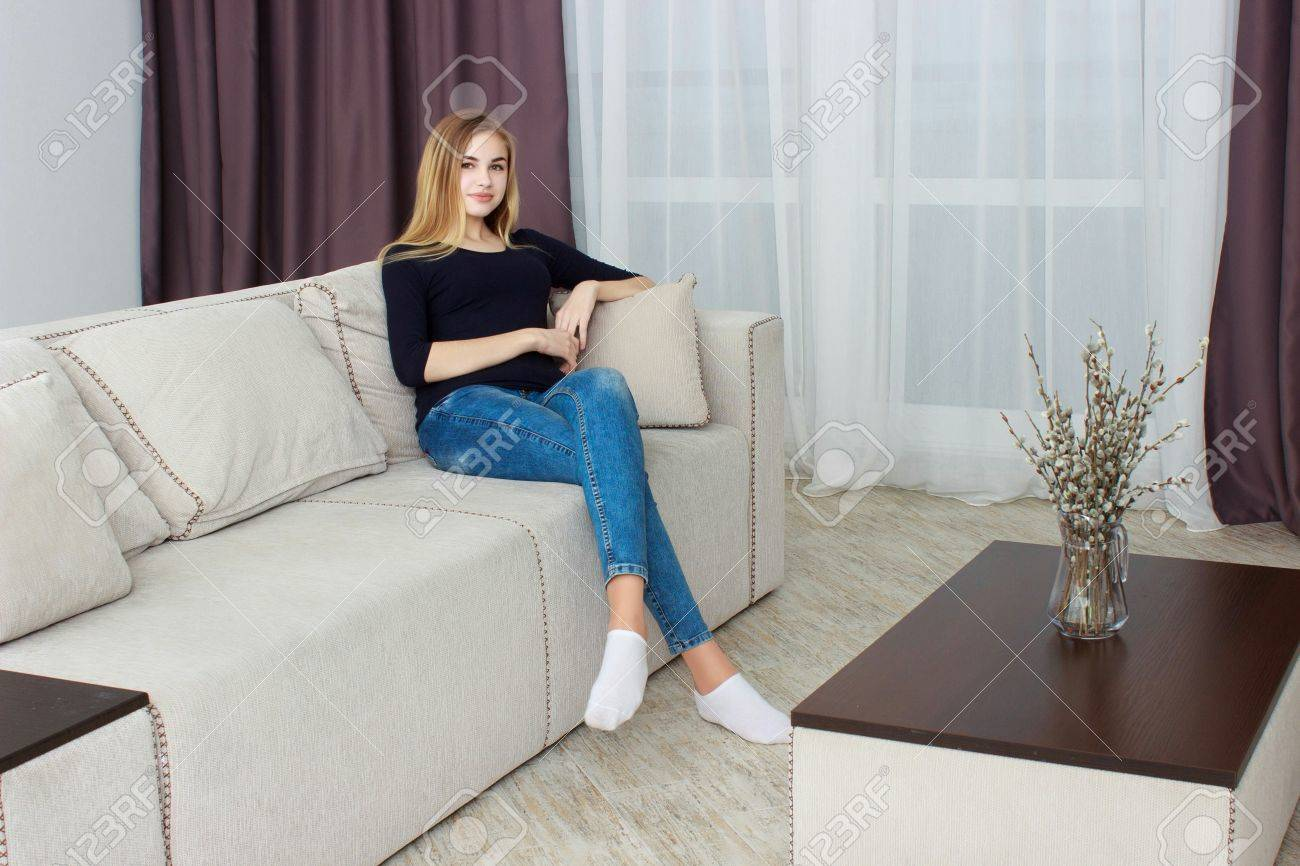 tv sofa bed reviews consumer reports young woman watching home in stock photo picture and