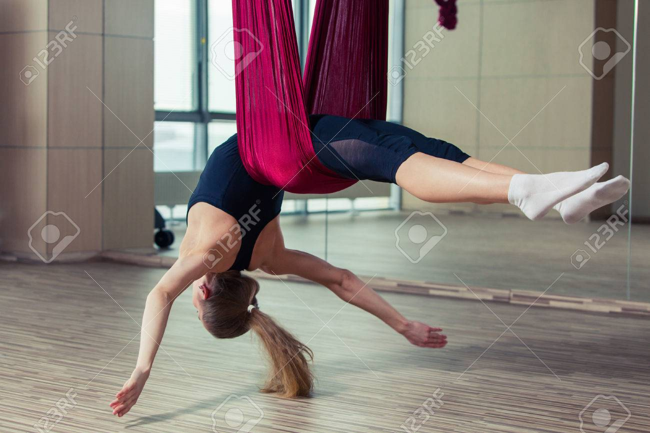 aerial yoga practicing anti
