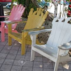 Painted Adirondack Chairs Folding Chair Hanging Rack Row Of Three Colorful Stock Photo Picture 2670178