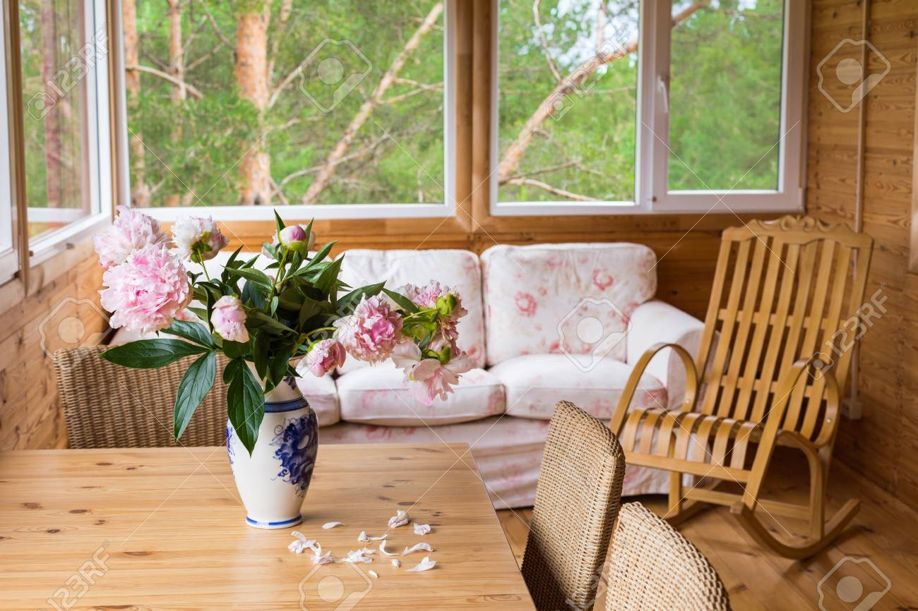 sofa rocking chair the and company jobs a cozy terrace with furniture wooden peonies in