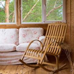Sofa Rocking Chair Cost To Recover Bed A Wooden And On The Porch Or Terrace With View Of