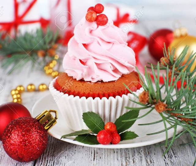 Cup Cake With Cream On Saucer With Christmas Decoration On Wooden Table Background Stock Photo