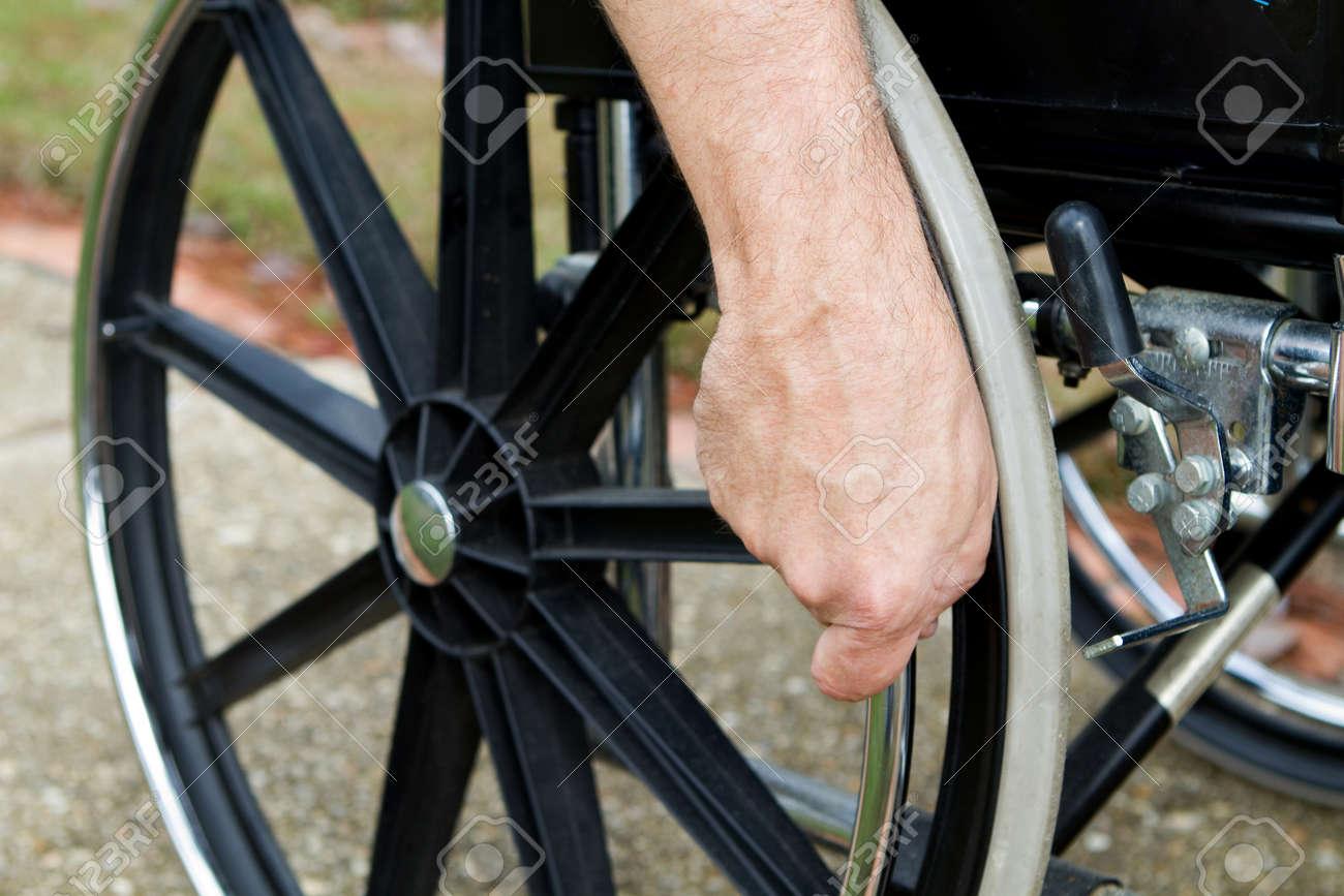 wheelchair grips garden chair cushions disabled man s hand the push rim on his stock photo 12474182
