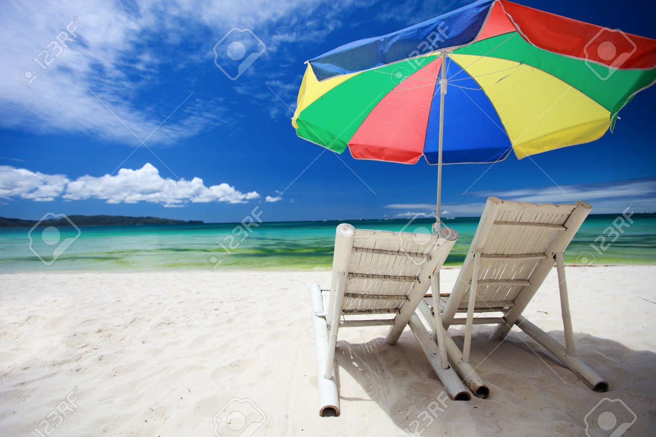 perfect beach chairs anti gravity sam s club two and colorful umbrella on tropical stock photo