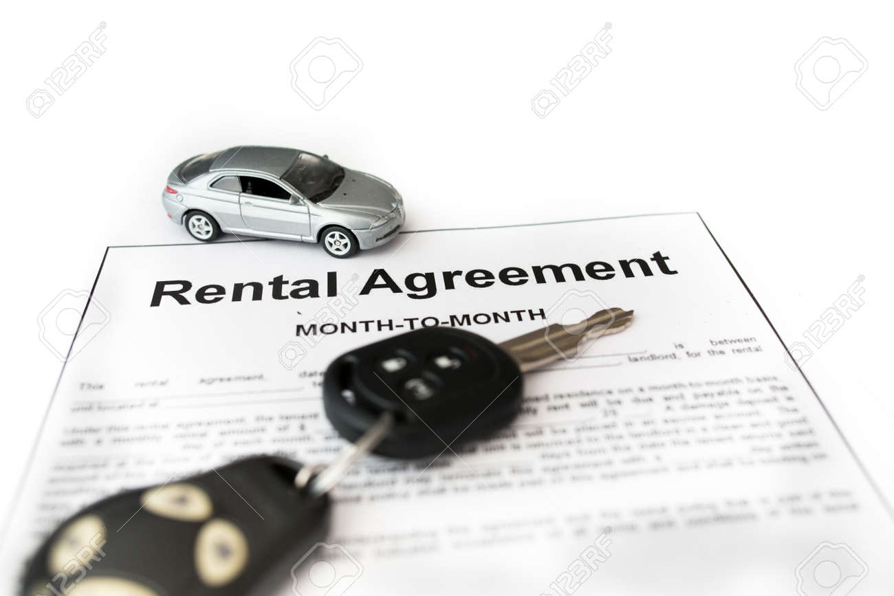 Car Rental Agreement With Car On Center. Auto Rental Agreement Or Legal  Document Stock Photo