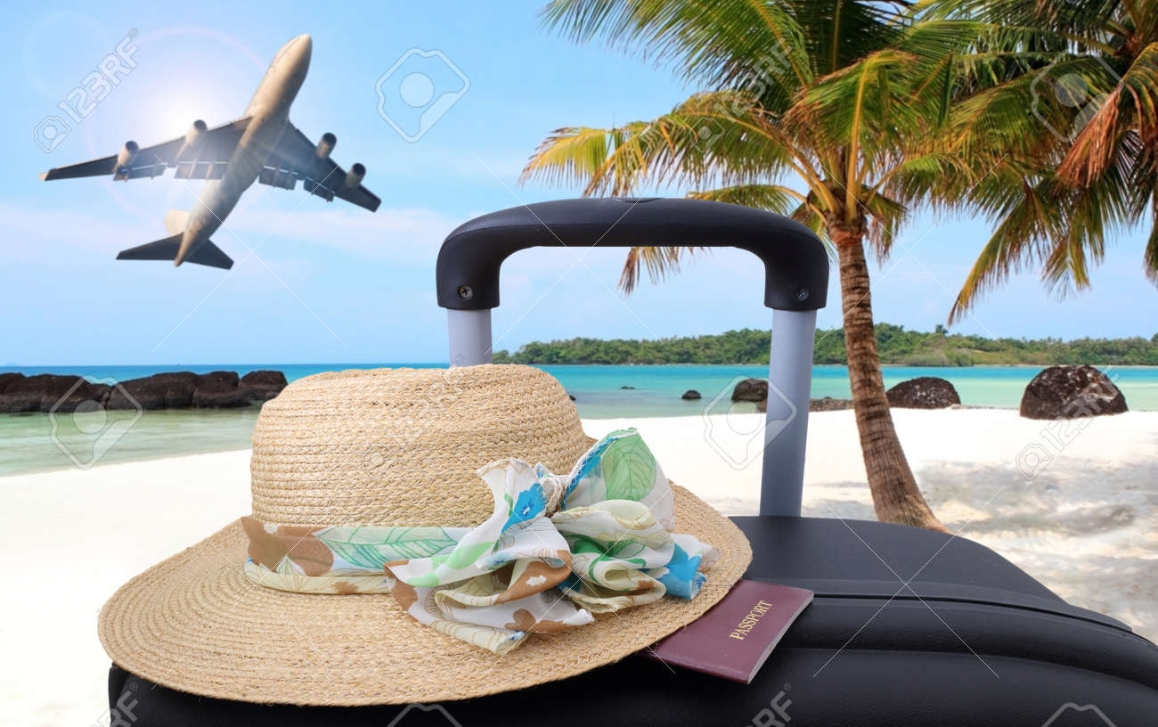 air travel beach chairs regency dining mahogany suitcase vacations luggage concept to chair on stock photo sand
