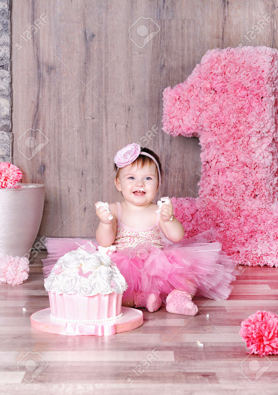 Cute Smiling Baby Girl Eating First Birthday Cake Smeared Face